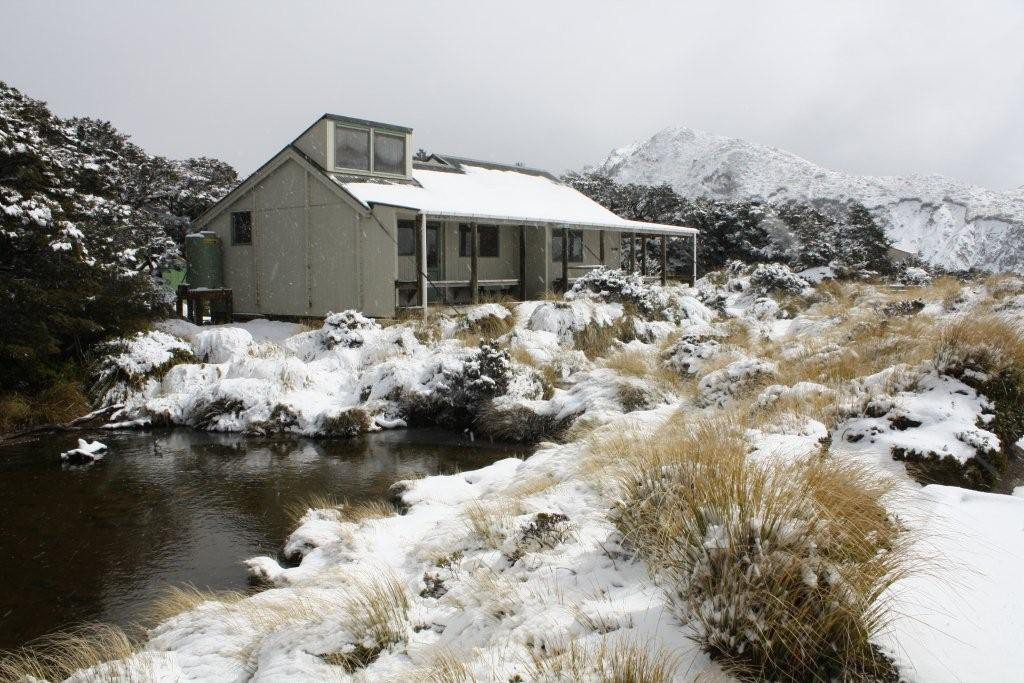 Sunrise Hut, in winter sun and snow. Photo by Keith Moretta