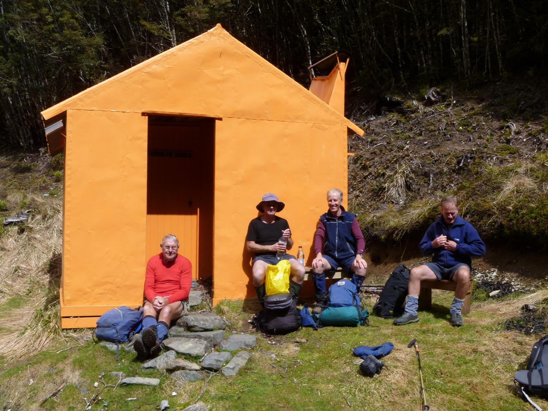 Ted, Matt, John and Murray enjoying the sunshine at Stuholme Hut. Photo by Geoff.