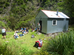 Having a final break before climbing up back to No Mans Road. Sitting outside Dianne's Hut.