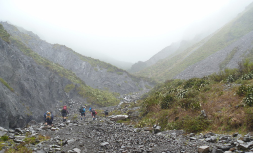 Heading up to Waipawa Saddle on a light drizzly day, with low visibility